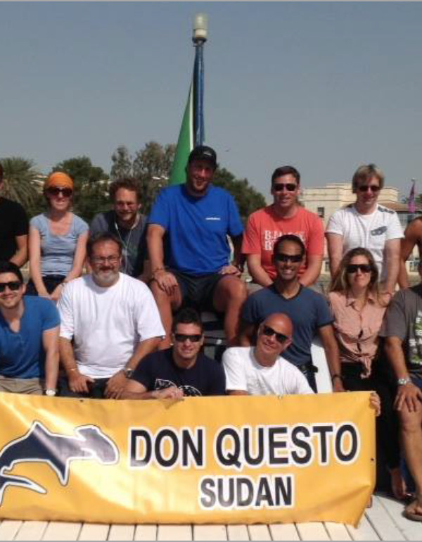 group picture of KAUS team on board Don Questo
